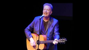 Tom Robinson with guitar